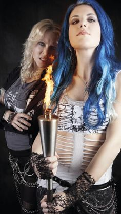 Alissa White-Gluz & Angela Gossow. PASSING THE TORCH: Graphic Description