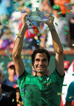 Roger Federer defeats Stan Wawrinka in the BNP Paribas Open final to claim his title in Indian Wells, Masters 1000 trophy and career title. At 35 years old he becomes the oldest men's singles player to win a Masters 1000 trophy. Atp Tennis, Sport Tennis, Tennis Trophy, Roger Federer Family, Indian Wells, Kim Clijsters, Stan Wawrinka, Tennis Online, Tennis Funny