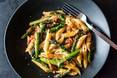 Craig Claibornes Pasta con Asparagi. A mashup of all the best pasta sauces -- tomato, asparagus, and carbonara -- with surprisingly harmonious results. You can add seafood, or any meat or poultry to make it more substantial. A great Italian Sausage would be great with this.