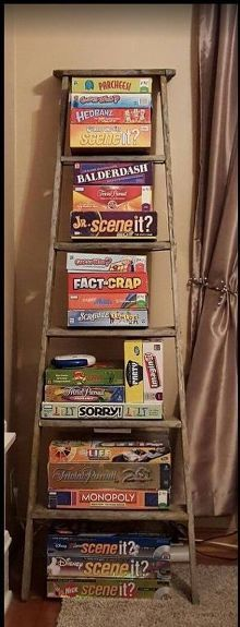 repurposed wooden ladder to board game storage, organizing, repurposing upcycling, storage ideas Game Room Design Monopoly, Geek House, Small Game Rooms, Family Game Rooms, Small Movie Room, Old Wooden Ladders, Wooden Ladder Decor, Game Room Basement, Basement Ideas