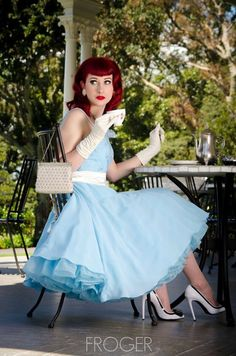 "jenniesissy: ""Lovely - the pale blue nylon or organza skirt overlying the tulle underskirt, rustling and swishing with every movement, gorgeous heels, the pinkie girlishly extended as she sips her..."