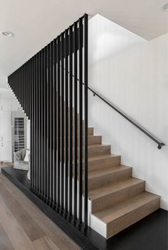 Modern Farmhouse Residence / Cornerstone Architects - - This modern farmhouse residence showcases the transitional blending of modern and traditional elements. By Cornerstone Architects. Staircase Design Modern, Stair Railing Design, Home Stairs Design, Stair Decor, Interior Stairs, Modern House Design, Staircase Ideas, Black Staircase, Stair Banister