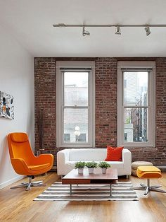 This is exactly what I want for my place. One brick feature wall...