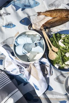 Ahti Table Cloth   Pentik   Designed by Lasse Kovanen, Ahti tablecloth attracts both smaller and bigger fishermen. This fisherman's favourite design brings to mind those hazy summer mornings, fishing trips and loon cries both in the cottage and at home.