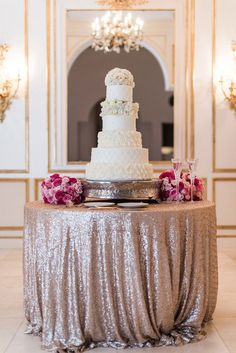 love the rose gold sequined tablecloth on this wedding cake table - so pretty!