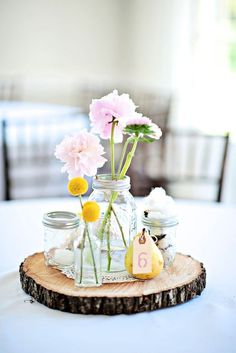 Use a wood slice as the base for a table centerpiece | At Home in Love