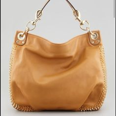 Rebecca Minkoff tan studded hobo Gorgeous tan leather Rebecca Minkoff hobo with studded detail around edge of bag.  Fun blue/black leopard lining inside bag with generous pockets.  Additional back zip pocket on outside of bag.  Well-loved and bag has some minor discoloration on handle (as shown in picture) and a few tiny spots on bag.  Not noticeable when carrying- price reflects these imperfections. Will include dust bag with purchase Rebecca Minkoff Bags Hobos