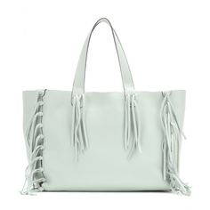 Valentino - C-Rockee leather tote - Valentino's 'C-Rockee' tote is constructed from soft, grainy mint-green leather. Unlined and finished with fringed tassels, this roomy piece boasts a bohemian aesthetic that will bring an instant hit of chic to your look. seen @ www.mytheresa.com