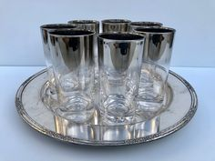 Excited to share this item from my #etsy shop: Vintage, Silver Fade, Tumblers, Set of 9, Queens Lusterware, Gradient Fade Glasses, Platinum, Ombre, Dorothy Thorpe Style, Barware, Pristine #clear #silver #glass #silverfadetumblers #dorothythorpestyle #queenslusterware #ombrefadeglasses #gradientfade #vintagetumblers Vintage Colors, Vintage Silver, Tumblers, Clear Glass, Queens, Vintage Fashion, Porcelain, Pottery, Ceramics