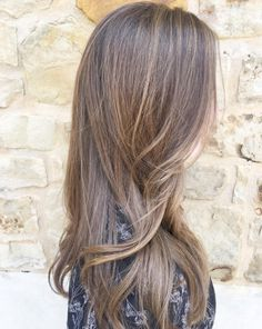 A natural balayage is all you need to mimic beachy, sunkissed highlights. Angelina Seyler of @hairslayedbyangelina created this perfect light brown color on long hair. Aveda color formula in the comments.