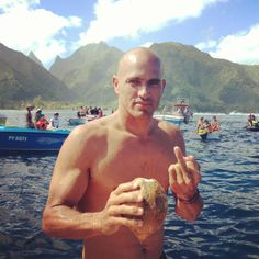 Kelly Slater at Teahupoo, Tahiti. I mainly use my iPhone to capture cheeky photos, and I was trying to get video of Kelly drinking his coconut, looking very majestic with the mountains in the background. He caught me, and told me off. Romantic Vacations, Romantic Travel, Young Kelly Slater, Shaved Head Styles, Skinhead Men, Bald Men, Hairy Men, Surfing Tips, Surfer Magazine