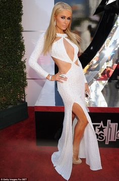 Very revealing: Paris Hilton cut a sexy figure in a shimmery white gown with plunging cleavage and cut-outs and high slit that showed lots of skin at the BET Awards in LA on Sunday