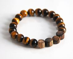 Men's Bracelets - Men's Jewelry - Men's Tiger Eye and Wood Bead Bracelets- Beaded bracelet- Unisex bracelets--Stretch Bracelet- Valentine's by FerozasjewelryForMen on Etsy https://www.etsy.com/listing/175890736/mens-bracelets-mens-jewelry-mens-tiger
