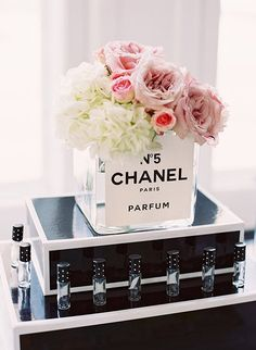 When you're as chic as this bride-to-be a Coco Chanel themed bridal shower is the only option. But Mademoiselle Coco isn't the only thing Parisian about the soiree. Planned by Cocktails and Details Chanel Bridal Shower, Paris Bridal Shower, Bridal Shower Favors Diy, Bridal Shower Tables, Bridal Shower Centerpieces, Bridal Shower Party, Wedding Favors, French Bridal Showers, Garden Bridal Showers