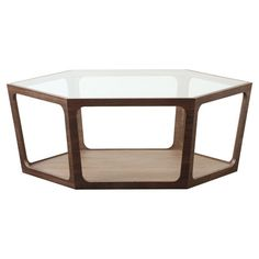 With its distinctive hexagonal silhouette, this glass-topped wood coffee table brings chic appeal to your decor. Use its lower shelf to stack glossy magazine...($398)