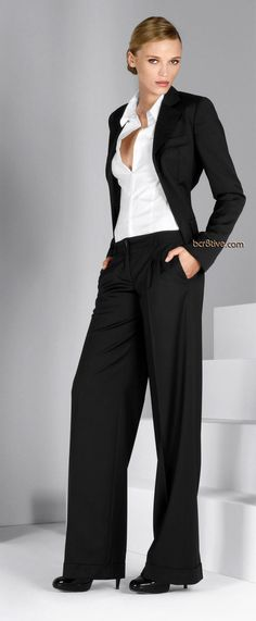 Anna Tokarska basic black pantsuit  with white shirt. Baggy yet perfect for the office!  I love this!