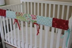 A necessity...to mask the chewed up crib rail from baby's teeth!  Could cut up old swaddling blankets to make it!  Perfect!!!