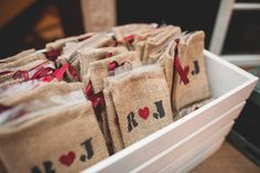 Burlap pouch wedding favors with bride and grooms initals at Willowdale Estate in Topsfield, MA www.willowdaleestate.com