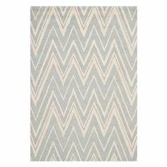 Hand-tufted wool rug with a chevron-inspired motif.  Product: RugConstruction Material: WoolColor: Grey and ivoryFeatures: Hand-tufted Note: Please be aware that actual colors may vary from those shown on your screen. Accent rugs may also not show the entire pattern that the corresponding area rugs have.Cleaning and Care: Professional cleaning recommended