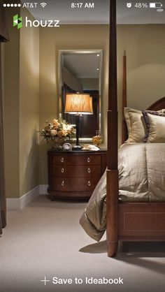 Tall mirror over nightstand opens up the room