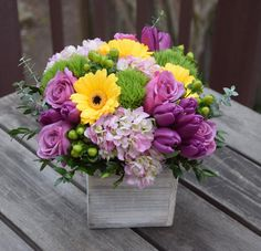 Floral gift box with purple blooms, yellows and greens. Yellow Flower Arrangements, Beautiful Flower Arrangements, Flower Centerpieces, Flower Decorations, Tulips Flowers, Purple Flowers, Cactus Flower, Flowers Garden, Yellow Rose Flower