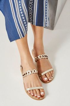 Artemis sandals are handmade in Athens, Greece of fine quality gold leather with comfortable anti-slip rubber outsole. They are so lightweight that they feel as if you're wearing virtually nothing at all. This classy flat pair has a minimalist design, with two straps, one plain and one with our signature woven technique. Wear them on summer vacation or around the city, simply adjust the buckled strap to find a perfect fit. There's practically no color that this metallic pair won't go with. Leather Sandals Flat, Gold Sandals, Flat Sandals, Artemis, Minimalist Design, All Or Nothing, Gold Leather, Perfect Fit, Metallic