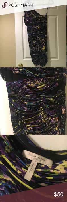 BCBG Runway Multicolored Party Dress - S BCBG Runway multi colored (purple, yellow, blue, light pink) splatter style rouched party dress. Amazing! Black mesh cutouts throughout the bodice, and one shoulder/sleeved style. BCBGMaxAzria Dresses Mini