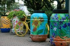 Plastic containers as decorated rain barrels a great DIY!