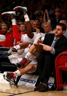 Russ Smith of Louisville falls over his teammate at the game against Syracuse. #bloopers #ncaa