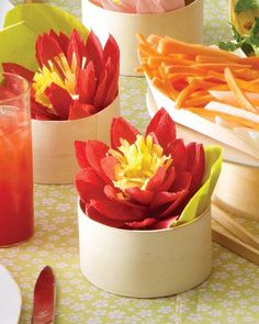 Lotus blossoms come in eye-catching fiery colors and these faux ones are no exception. Use smooth yellow tissue paper for the fringed stamen and more crinkly textured crepe paper for the petals.
