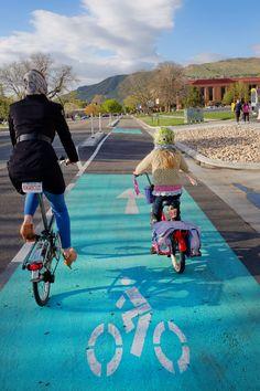 Protected bike lane on 200W helps create a family friendly biking network in Salt Lake City.