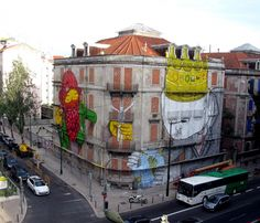 mural collaboration between Os Gemeos and Blu