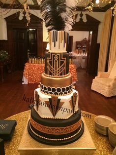 Great Gatsby themed wedding cake with gold and black accents to match the venue.
