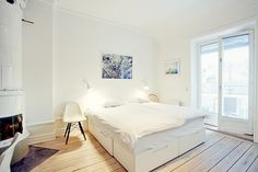 I love the loft style of the bedroom!!! Side tables or mirrors instead of the chairs though..