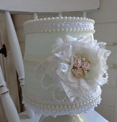 Gorgeous lace, ribbon flower and bead embellishments.