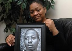 Venida Browder, 62, holds a picture of her son Kalief, who killed himself after beating a robbery rap that had kept him jailed at Rikers.