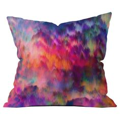 Add a pop of style to your sofa, arm chair, or window seat with this delightful pillow, showcasing an abstract multicolor motif. Made in the USA.