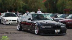 Black BMW e36 coupe slammed on OZ Breyton wheels