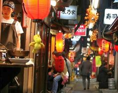 Yakitori Alley, Tokyo- The birthplace of Yakitori (Japanese appetizers of grilled meat skewered on a bamboo skewer)