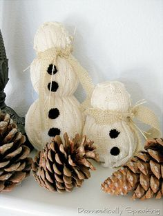 Sweater snowman - simply foam balls glued together and slid inside the sleeve of an old sweater