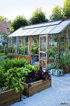 Working vegetable garden with greenhouse and wooden raised beds                                                                                                                                                                                 More