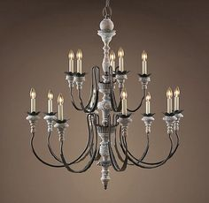 If you have really high ceilings and a large room, you might want to consider a two-tier fixture like this Parisian Wood & Zinc chandelier from Restoration Hardware--Dining Room