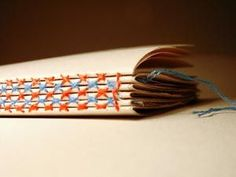 Cross stitch book binding by Evelin Kasikov