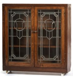 Arts & Crafts Bookcase with Leaded Glass doors - Sold at Auction - Cowan's Auctions -  Price Realized: USD 146.88