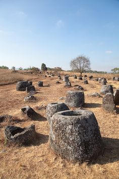 The Plains of Jars. Thousands of giant stone jars are scattered around the Xieng Khouang plain in Laos. Excavation by Lao and Japanese archaeologists has supported the conclusion that these were funeral megaliths, with the discovery of human remains, burial goods and ceramics found in association with the stone jars. The Plain of Jars is dated to the Iron Age (500 BCE to 500 CE). Image: Anne Murray.