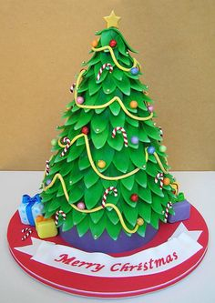 Impressive looking Christmas tree cake. It's given me some ideas - icing gifts coming up!