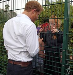 Despite his busy day Prince Harry spared time to those who had waited on the other side of a fence hoping to catch a glimpse of the royal