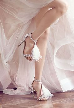 The British label's wedding collection for the 2016 season is packed with more Swarovski crystal, feathers and sequins than you can shake a satin pump at, complete with the minaudières to match. And with couture touches like bespoke personalization, Jimmy Choo's bridal offering is certainly Vogue-approved.