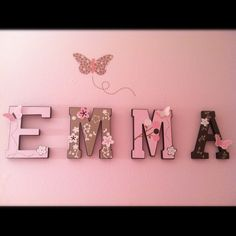Pink and brown butterfly name wall hanging for Emma's room. Made with our silhouette cutting machine and some craft letters from Michael's. This was designed by my husband to match our crib bedding set that was given to us as a gift. :-)