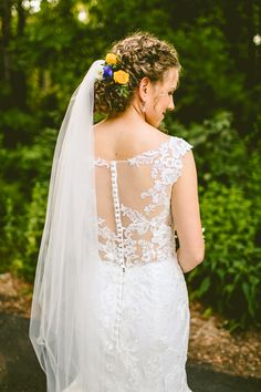 Photography: Carolyn Scott Photography Hair and Makeup: Wedding Hair by Liz Venue: The Museum of Life + Science Event Planning: Events by Memory Lane  #weddinghair #updo #flowers #curly #boho #veil
